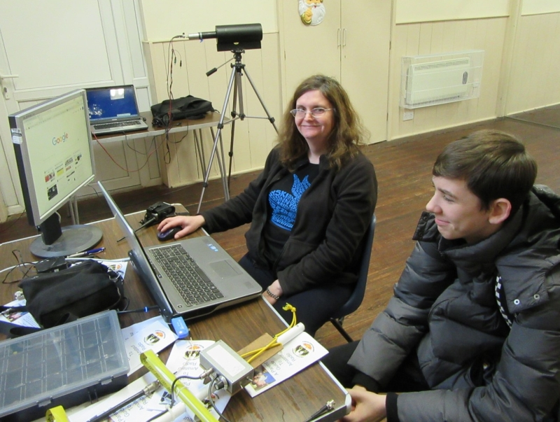 Ben Copeland SWL (scout) watching satellite reception on a laptop with £6 RTL dongle and Heather M0HMO